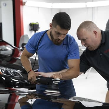 Instructor DJ Mayo helping one of the class attendees to find that perfect balance on the machine for the best results.s